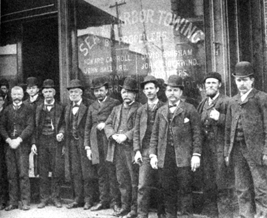 <em>Michael Moran (holding cigar, fourth from the left), with his associates on South Street, then known as the Street of Ships.</em>