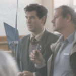 Pierce Brosnan discusses a scene with Evelyn director Bruce Beresford.