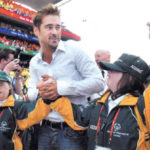 Colin Farrell is escorted by Team Ireland.