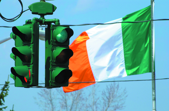 <em>The Tipperary Hill traffic light in Syracuse, New York that is green on the top instead of red. Walsh's father Jack Walsh, a proud Irish-American, hailed from this area.</em>