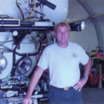 Terry Kerby standing in front of the Pisces IV.