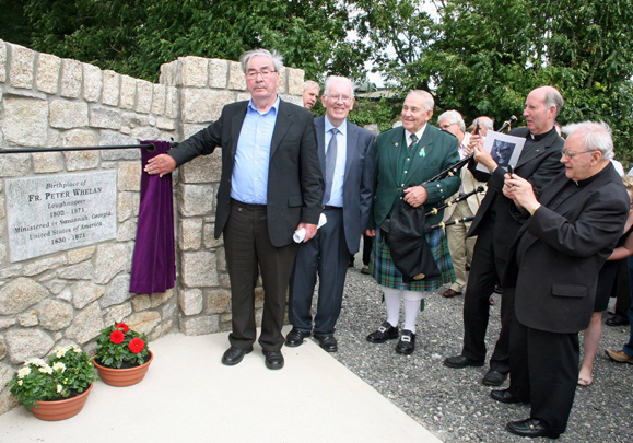 A group from Clongeen and Savannah dedicate a plaque to Fr. Whelan.