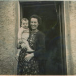 With his mother, Meg, in front of their thatched cottage home in Knockaderry, Limerick.
