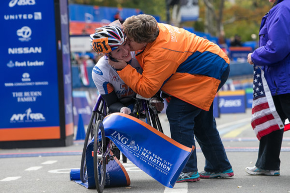 Tatyana McFadden is greeted by her mother, Debbie, at the finish line of the 2013 NYC Marathon