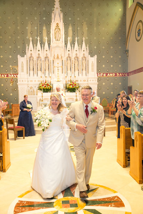 The bride and groom inside the newly-restored church. The altar was designed by James Renwick, who also designed St. Patrick's Cathedral in Manhattan.