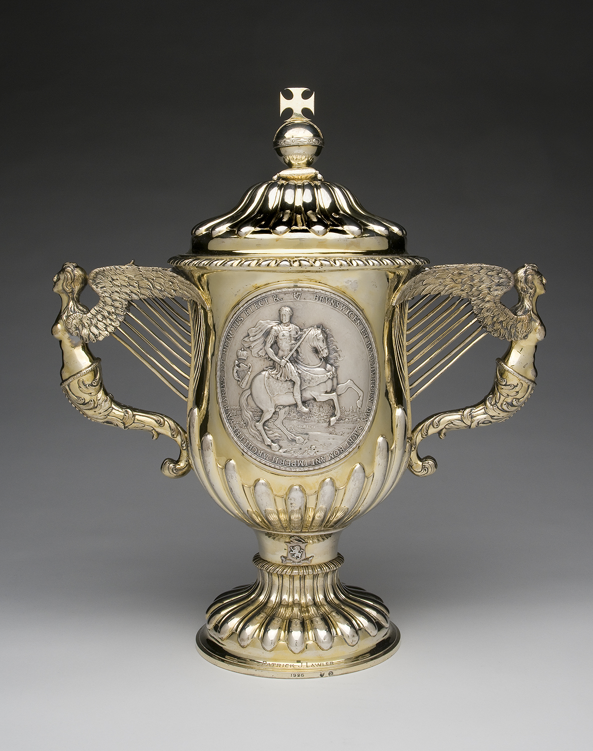 Two Handled Samuel Walker. Silver Cup and Cover, c. 1761 – 1766.  On loan from Philadelphia Museum of Art. Samuel Walker was one of a famous family of  silversmiths from Dublin. The exhibition also  features an extensive collection of Irish silver objects from the San  Antonio Museum of  Art, Texas.