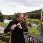 """Michael Flatley plays a traditional wooden flute for """"The Rising"""""""
