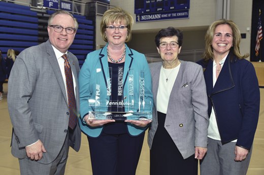 <em>Eileen accepted the 2017-2018 Neumann University Institute for Sport, Spirituality and Character Development Award. Pictured: Dr. Chris Domes (President of Neumann University); Eileen McDonnell; County Sligo native Sr. Marguerite O'Beirne, OSF (VP for Mission and Ministry); and Lee Delle Monache (Director of Neumann's Institute).</em>