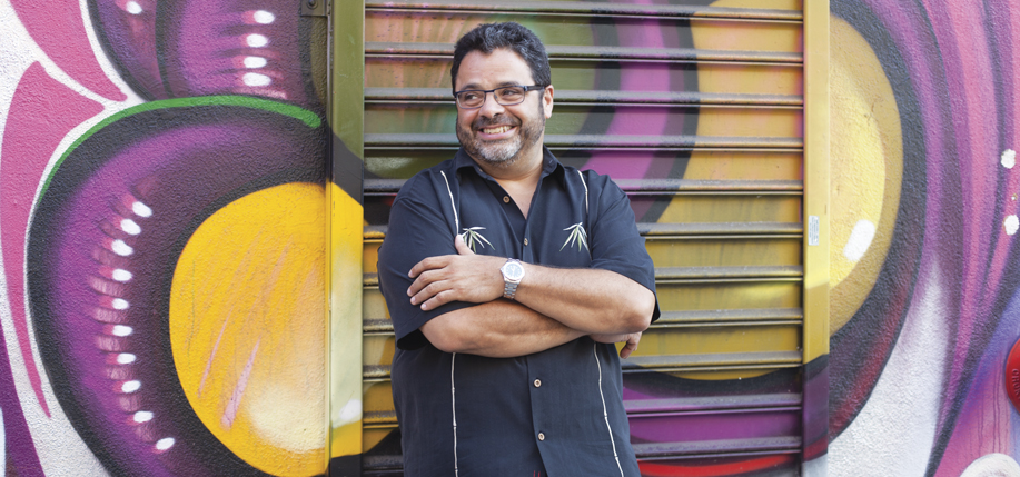 Arturo O'Farrill pictured in front of some Brooklyn street art.