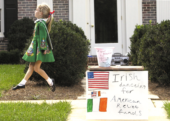 Collier Wimmer, aged 9, performs in front of her home in Winston-Salem, North Carolina to raise funds for the victims of the September 11 tragedy.