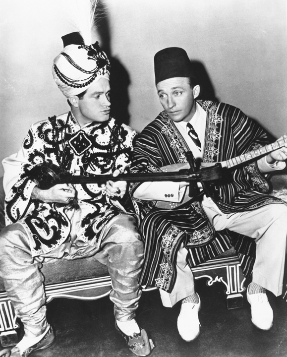 """<em>Crosby with his good friend, Bob Hope, in the <strong>Road to Morocco</strong> one of the many movies they made together, paving the way for all of the """"buddy"""" films that followed.</em>"""