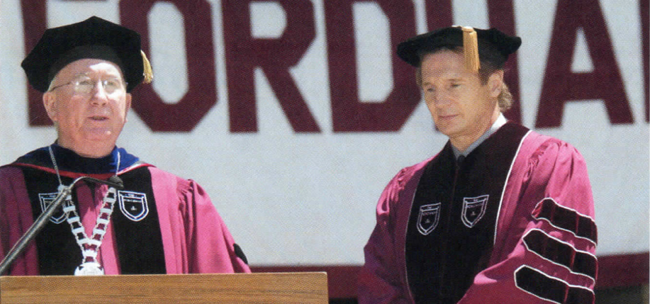 Father O'Hare with actor Liam Neeson who received an honorary Doctor of Fine Arts degree.