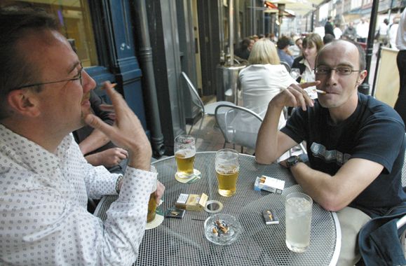 <em>Smoking wil be illegal inside of pubs as of January 1, 2004.</em>