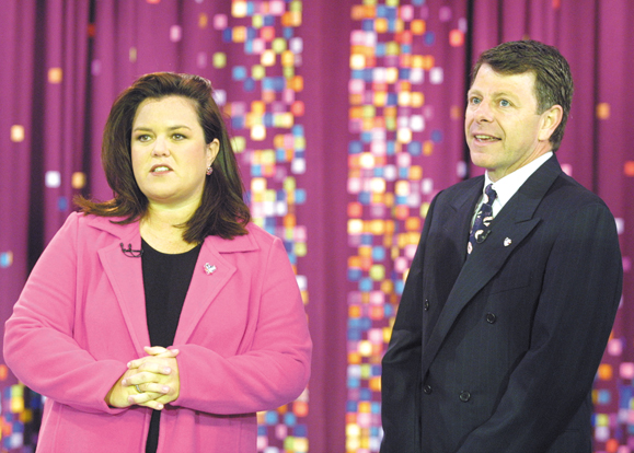 """Rosie O'Donnell welcomes Brian Connolly of AVON to """"The Rosie O'Donnell Show"""". The show has teamed up with the Avon Breast Cancer Crusade for Breast Cancer Awareness month during October 2001."""