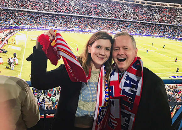 Maggie Holland and her father Dan at an Atlético Madrid game while on a trip to Spain in February 2017.
