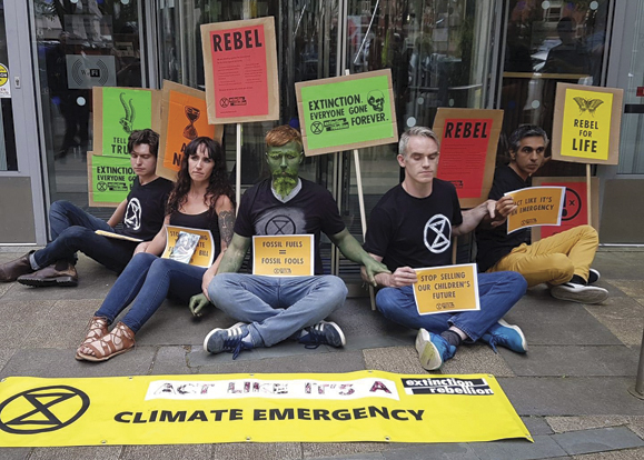 The climate action campaign group Extinction Rebellion Ireland stage a sitdown in Dublin on July 16.